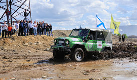 Off-road car in difficult terrain Stock Images