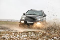 Off-road car driving through a puddle stock photos