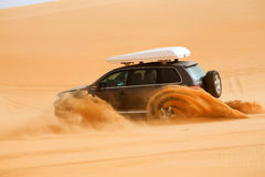 Off-road car fetching a dune, Libya - Africa. Black off-road car fetching a dune, Libya - Africa Stock Photography