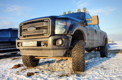 Off-road 4x4 car Ford on the road in the wintertime close-up. SAMARA, RUSSIA - FEBRUARY 14, 2015: Off-road 4x4 car Ford on the road in the wintertime close-up Royalty Free Stock Photography