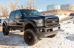 Off-road 4x4 car Ford on the road in the wintertime close-up. SAMARA, RUSSIA - FEBRUARY 23, 2015: Off-road 4x4 car Ford on the road in the wintertime close-up Stock Photo