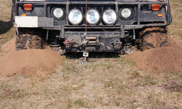 Off-road car. Front of the off road car is stuck in the sand Royalty Free Stock Photo
