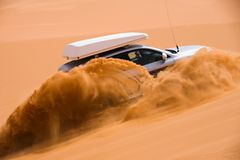 Off-road car going up the sand dune Royalty Free Stock Image
