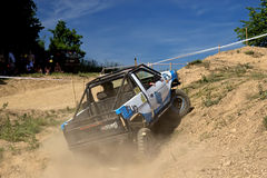 Off-road car is hitting a steep hill Royalty Free Stock Photos