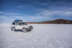 Off- road car on lake Salar de Uyuni, Bolivia Stock Photo