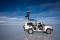 Off- road car on lake Salar de Uyuni, Bolivia stock image