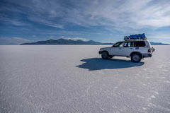 Off- road car on lake Salar de Uyuni, Bolivia royalty free stock image