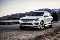 Off-road german car VW Touareg without logos on a winding mountain road. Off-road car without logos on a winding mountain road. The photo is suitable for stock photography