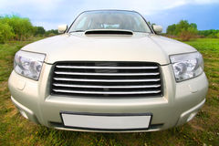 Off-road car on meadow front view Royalty Free Stock Photos