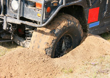 Off-road car. Mud wheel close-up on a vehicle participating in off-road challenge Royalty Free Stock Photography