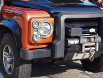 Off Road Car. Off-road car orange 4X4, with a front winch - Detail Royalty Free Stock Image