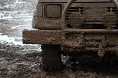 Off road car participating. In a dirt Royalty Free Stock Images