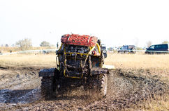 Off-road car in a puddle making mud splashes. Stock Photo