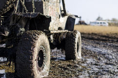 Off-road car in a puddle making mud splashes. Stock Images