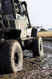 Off-road car in a puddle making mud splashes. Royalty Free Stock Photo