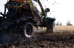 Off-road car in a puddle making mud splashes. Stock Image