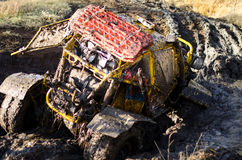 Off-road car in a puddle making mud splashes. Stock Photos