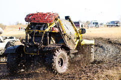 Off-road car in a puddle making mud splashes. Stock Photography