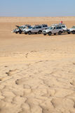Off-road car at rest in Sahara desert Stock Photos