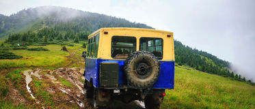 Off-road car rides on the swamp road in the mountains at rain weather, Carpathians, Ukraine. Off-road car rides on the swamp road in the mountains at rain Stock Images