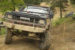 Off-road car in rough terrain Stock Photo