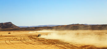 Off road car with it's pilot in Morocco. Panoramic view on convoys of off road cars with in Morocco desert near Merzouga Stock Image