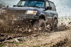 Off road car. Sprays mud Stock Photography