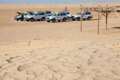 Off-road car at stoppage in desert not in focus Stock Photography