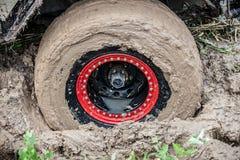 Off road car stuck in deep mud. Royalty Free Stock Photos