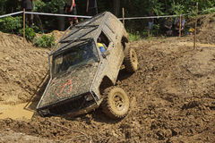 Off road car stuck in a muddy terrain. MOHELNICE, CZECH REPUBLIC - JUNE 09. Off road car stuck in a muddy terrain in the BIG SHOCK CUP Trial 2013 on June 09 Royalty Free Stock Photos