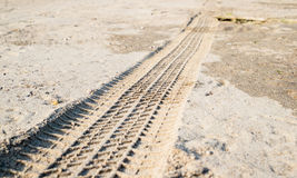 Off road car tyre track on sandy beach. Close view Royalty Free Stock Image