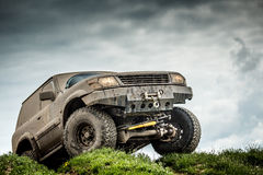 Off road car. Very muddy off road car Royalty Free Stock Image