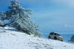 Off-road car on winter landscape Stock Photo
