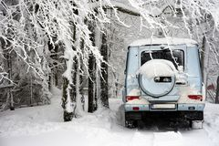Off-road car in winter snow stock photo