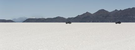 Off-road cars in the Salar de Uyuni is largest salt flat in the World UNESCO World Heritage Site - Altiplano, Bolivia Royalty Free Stock Photo
