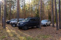 Off-road club. SUVs parked in a clearing in the woods stock images