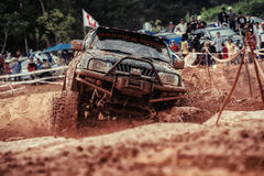 Off-road 4x4 competition. Off-road racing on August 2014 at Suratthani. Thailand,Free of charge,Open event Royalty Free Stock Photo
