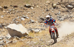 Off Road Dirt Bike Racer with Dust Plume Royalty Free Stock Photos