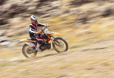 Off Road Dirt Bike Racer Panning Shot Royalty Free Stock Photography