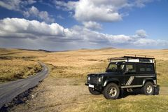 Off-road drive. 4x4 car in a open space, Dartmoor, England Royalty Free Stock Photo