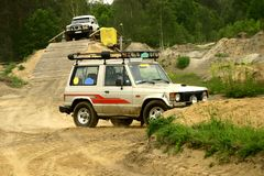Off road driving. Two four-wheel drives racing off-road Royalty Free Stock Image