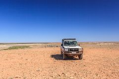 Off road driving with Toyota Land Cruiser through the Outback of South Australia. Somewhere along the Oodnadatta Track in South Australia, Australia, 19 december stock photos