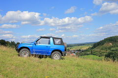 Off-road excursion. Off-road. 4x4 jeep at the top of a hill Stock Image
