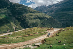 Off road expedition vehicle on the mountain road among Himalaya Stock Image