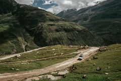 Off road expedition vehicle on the mountain road among Himalaya royalty free stock image