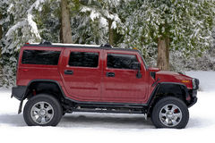 Off Road Hummer H2 In The Snow Royalty Free Stock Images