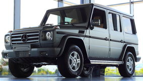 Off road icon: Mercedes-Benz G Class. Close-up on new Mercedes-Benz G Class in showroom Stock Images