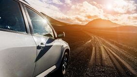 Off-road Jeep car on bad gravel road Stock Image