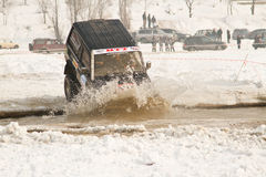 Off-road jeeps riding in the river at races. Stock Photo