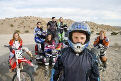 Off Road Motor Biker Standing With Friends In The Background  Stock Images